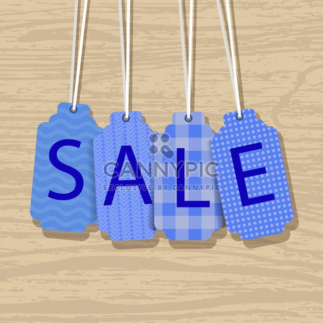 Blue sale labels on wooden background - Free vector #132143