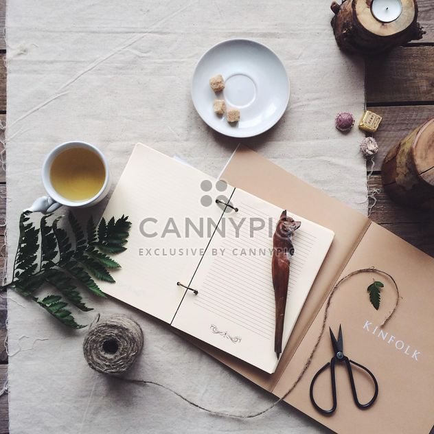 Notebooks, cup of tea and decorations - Free image #136513