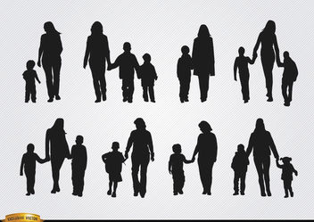 Mothers walking with sons silhouettes - Free vector #182373