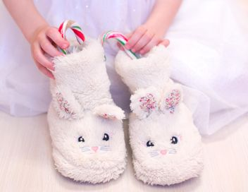 Warm slippers with candies in child's hands - Free image #182553