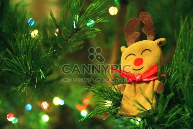 A deer toy in the branches of spruce, new year, Christmas composition - Free image #182603
