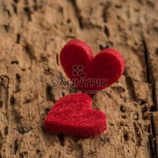 Felted hearts on wooden surface - Free image #182943