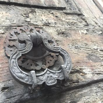 Closeup of old door knocker on wooden door - Free image #183123