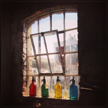 Colored bottles on the window - image #183573 gratis