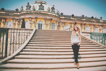 Pretty girl on the stairs of Sans Souci palace - image #183633 gratis