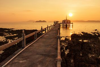 Bridge to temple in sea at sunset - image #183853 gratis
