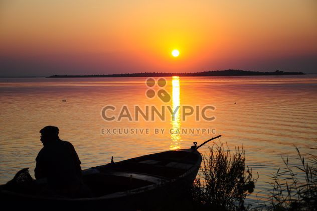 silhouettes of fishermen on lake - Free image #185773