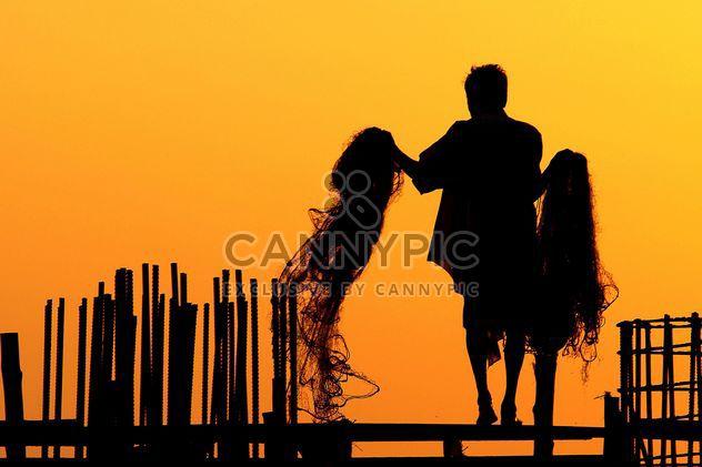 Silueta de pescador -  image #186403 gratis