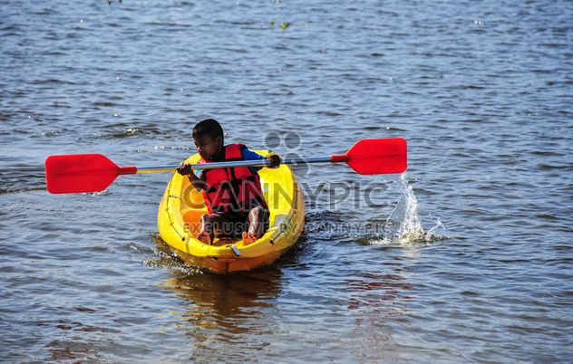 Boy in kayak on the river - Free image #186513