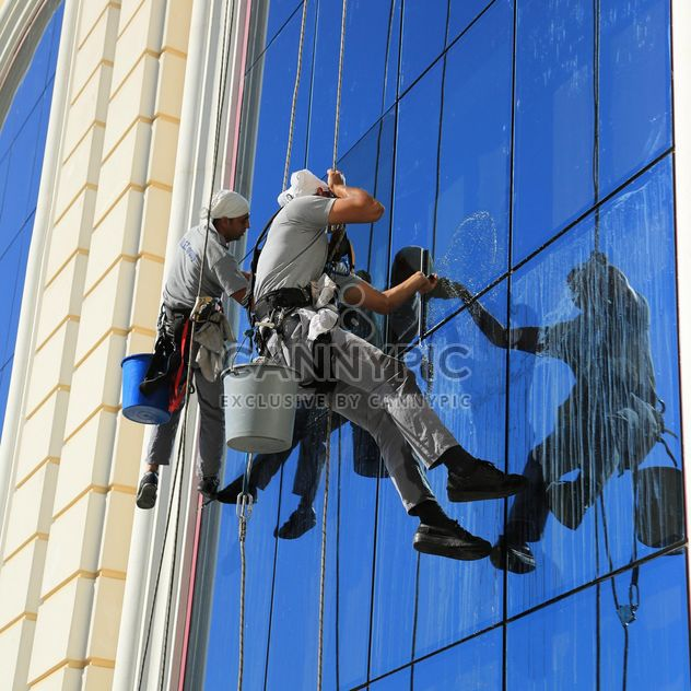 Workers wash windows - Free image #186643