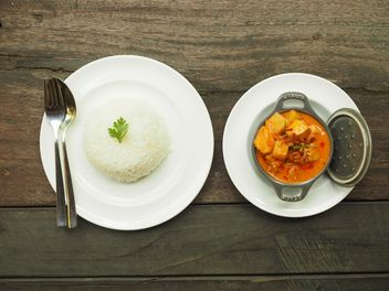 Mussamun Kai curry on wooden background - Free image #187053