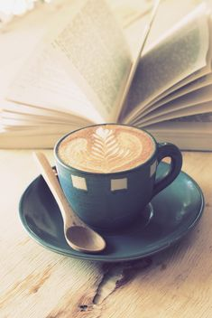 Coffee latte art and open book on wooden table - image #187073 gratis