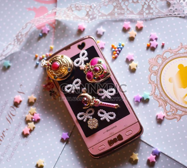 pink smartphone with little white hearts and and bows on white background - Free image #187263