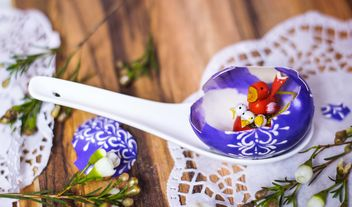 Wooden birds in purple Easter egg - image #187443 gratis