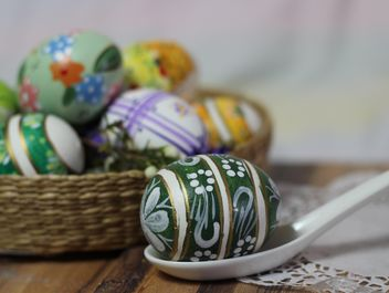 Painted Easter eggs on table - бесплатный image #187543