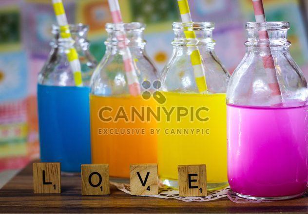 Bouteilles de boissons colorées - Free image #187613
