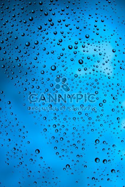 Water drops on blue background - Free image #187663