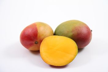 Two and half Mangoes isolated on white background - Free image #187793