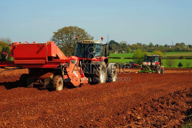 Tractor ploughing field - Free image #198353
