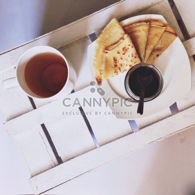 Pancakes with jam and cup of tea - Free image #198493