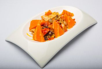 Dish of pumpkin on the plate on white background - Free image #198723