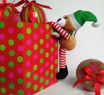 Teddy bear and Christmas toys in colored box on white background - Free image #198813