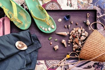 Shells, stones, flip flop and wicker bag - image #198933 gratis
