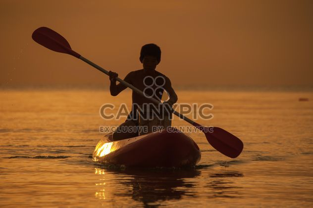 Fisherman in a boat - Free image #271823