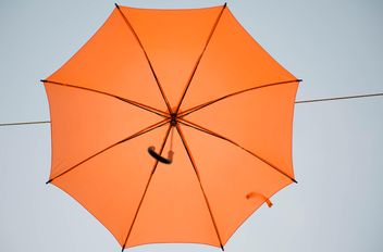 Orange umbrella hanging - image #273083 gratis