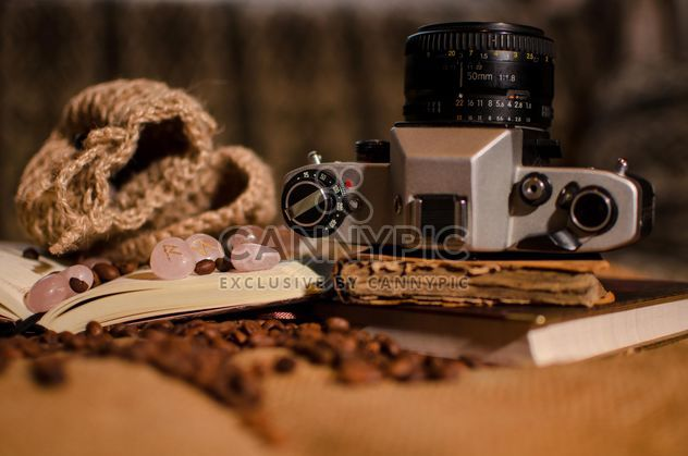 Old camera, books, runes and coffee beans - image #275323 gratis