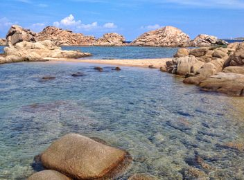 Rocks on the beach and crystal clear sea water, Sardinia island, Italy - image #297483 gratis