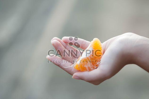 peeled tangerine in hand - Free image #301973