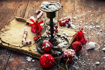Candlestick, old book and Christmas decorations - бесплатный image #302023