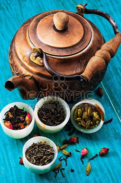 Copper teapot and dry tea in small bowls - Free image #302083