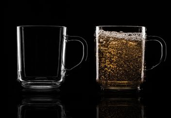 Glass cups on black background - image gratuit #303223
