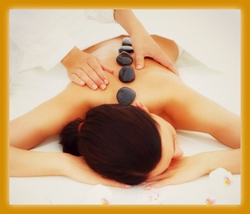 Beautiful woman receiving hotstone massage at spa - image gratuit #309383