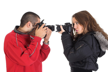 Young man and woman taking pictures of each other - image #313993 gratis