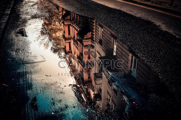 Reflection of houses in puddle - Free image #317403