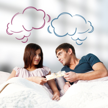 Closeup portrait of adult couple lying on their bed at their apa - image #317953 gratis