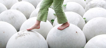 Free Child Walking on White Round Spheres Balance Creative Commons - Free image #318493