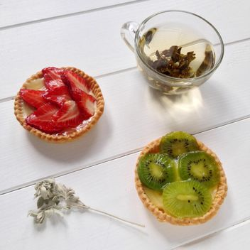 Cup of tea and tarts with kiwi and strawberries - Free image #329103