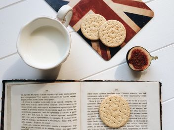 #foodmaria, Cookies, fig, open book and cup of milk on white background - Free image #329133