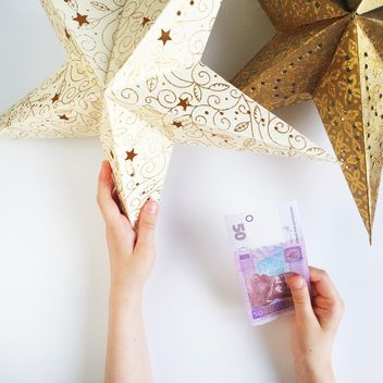 two stars and money on white background - image gratuit #329223