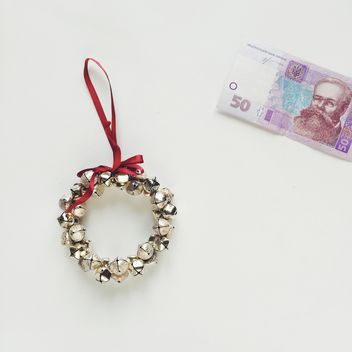Christmas wreath and money on a white background - Free image #329243