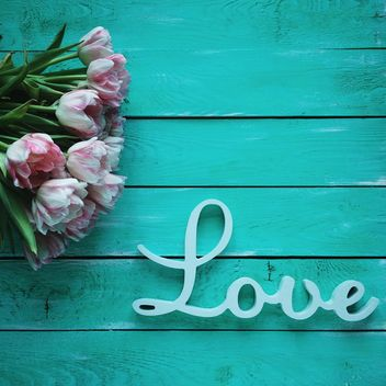 Tulips and word Love on green wooden background - бесплатный image #329303