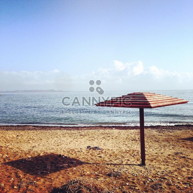 Beach umbrella on seashore - Free image #331763