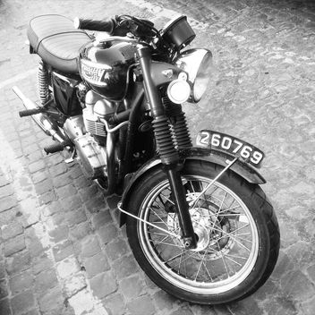 Triumph motorcycle on paving stone - image gratuit #332023