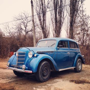 Old blue car in street - бесплатный image #332143