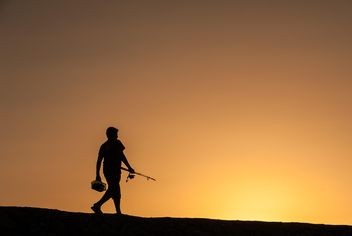Silhouette of fisherman at sunset - Kostenloses image #338523