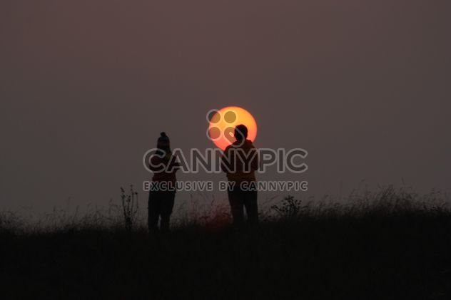 Couple looking at sun - Free image #338533